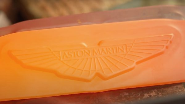 The Aston Martin badge is forged in fire at 1,472 degrees